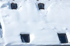 Mansard covered with white snow. Four mansard windows covered with snow Royalty Free Stock Photos