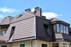 Free Mansard Floor Of A Mansion With A Roof From A Metal Tile Royalty Free Stock Photos - 55555138