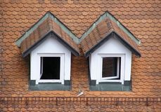 Mansard roof. Two mansards on the roof Royalty Free Stock Photos