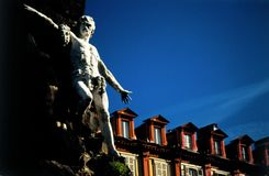 Mansards statue. Statue and mansards in Turin, Italy royalty free stock photography
