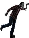Manseriemördaren med maskerar full längd för silhouette Royaltyfria Bilder