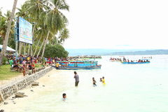 Mansinam Island, West Papua. Crowdy people by the beach celebrating an annual big religious celebration in Manokwari, West Papua (5 February 2017). The 162th stock image