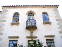 Mansion. Rear view of Spanish type mansion, with interesting balcony and arched windows stock photography