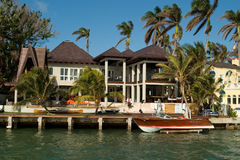 Mansion with boat Stock Photo