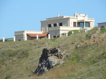 Mansion on a cliff near the sea Stock Images