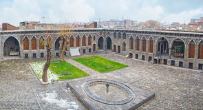 The mansion in Diyarbakir. DIYARBAKIR, TURKEY - JANUARY 15, 2015: The view of the courtyard of Cemil Pasha mansion iwith the small fountain and decorated basalt Royalty Free Stock Images