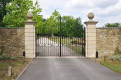 Mansion Gate. Gate and Drive of a Country Mansion Stock Photos
