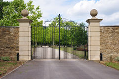 Mansion Gate. Gate and Drive of a Country Mansion Royalty Free Stock Image