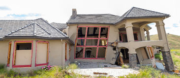 Mansion home crumbles under the shifting earth Royalty Free Stock Photo