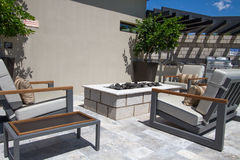 Mansion home outdoor plaza patio with firepit Stock Image
