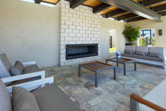 Modern home outdoor plaza patio with fireplace Royalty Free Stock Images