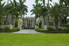 Mansion house. And palm trees royalty free stock photos