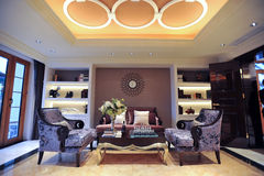 Mansion living room. Black flower sofas in a Classical designed living room in a mansion Stock Photo