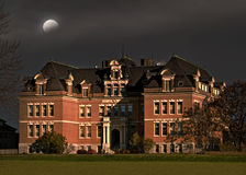 Mansion at nighttime Stock Images