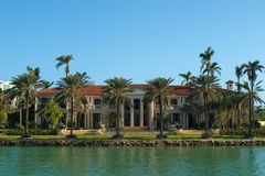 Mansion with Palms Royalty Free Stock Images