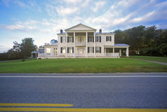 Mansion by roadside stock photography