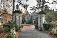 Mansion with stone lions and columns Stock Image