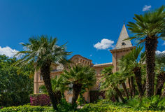Mansion under the blue sky. The Sama Park is unusual garden built at the end of the 19th century in the colonial style It has beautiful an artificial lake with Royalty Free Stock Photography