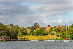 Mansions on the banks of the Parramatta River in cloudy weather Stock Photos