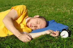 Mansleeping in summer meadow Stock Photo