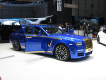 Mansory's Phantom. A blue and gold Rolls Royce Phantom tuned by Mansory shown at the Geneva autoexpo in 2010 Royalty Free Stock Photography