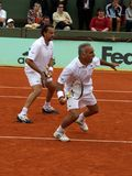 Mansour Bahrami and Henri Leconte. PARIS - JUNE 1: Retired tennis players Mansour Bahrami and Henri Leconte play tennis in double at the Roland Garros Open on Stock Image