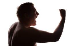 Manståendesilhouetten profilerar att skrika Fotografering för Bildbyråer