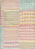Manta en colores pastel del ganchillo del bebé Fotografía de archivo