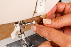 Mantainance of a sewing machine Stock Images