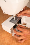 Mantainance of a sewing machine Royalty Free Stock Photo