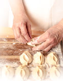 Mantas_cooking_process_27. Woman who is cooking dumplings Stock Image