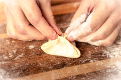 Mantas_cooking_process_15. Woman who is cooking dumplings Royalty Free Stock Images