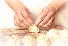 Mantas_cooking_process_22. Woman who is cooking dumplings Stock Images