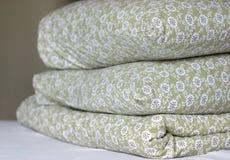 Mantas y almohadillas de la pluma Imágenes de archivo libres de regalías