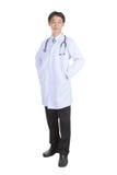 Manteau blanc de port de docteur Photo stock