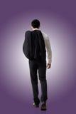 Manteau de prise d'homme d'affaires photo stock