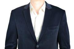 Manteau en gros plan de costume de bleu marine de velours pour les hommes, d'isolement sur le blanc Photographie stock