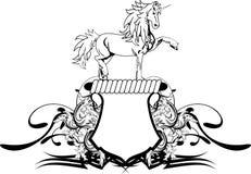 Manteau héraldique de licorne de bouclier de crête de bras Photos stock