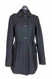 Manteau noir de femme Photographie stock libre de droits