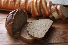 Manteiga com fundo do branco do pão Imagem de Stock Royalty Free