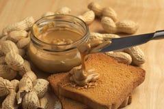 Manteiga de amendoim com biscoitos Foto de Stock