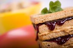 Manteiga de amendoim e sanduíche da geléia Fotografia de Stock