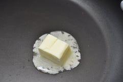 Manteiga de derretimento Fotografia de Stock Royalty Free