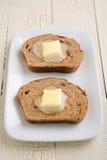 Manteiga do pão de raisin da canela Imagem de Stock
