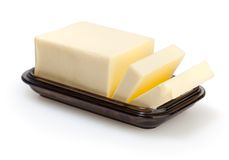 Manteiga em butterdish isolada no branco Fotos de Stock Royalty Free
