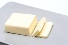 Manteiga em um platô cinzento Imagem de Stock