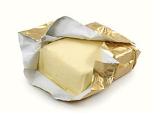 Manteiga na folha de ouro Fotos de Stock