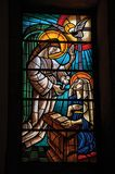 Colorful stained glass with religious theme. Manteigas, Portugal - July 14, 2018. View of colorful stained glass with religious theme at the church of Manteigas stock photo