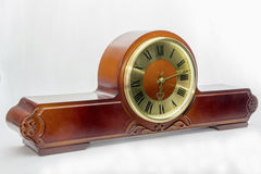 Mantel clock. Wooden antique mantel clock with golden dial Royalty Free Stock Photo