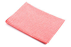 Mantel rojo de la tela escocesa doblado en dos fotografía de archivo